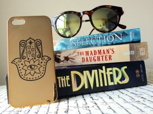 reflective sunglass books gold phone case